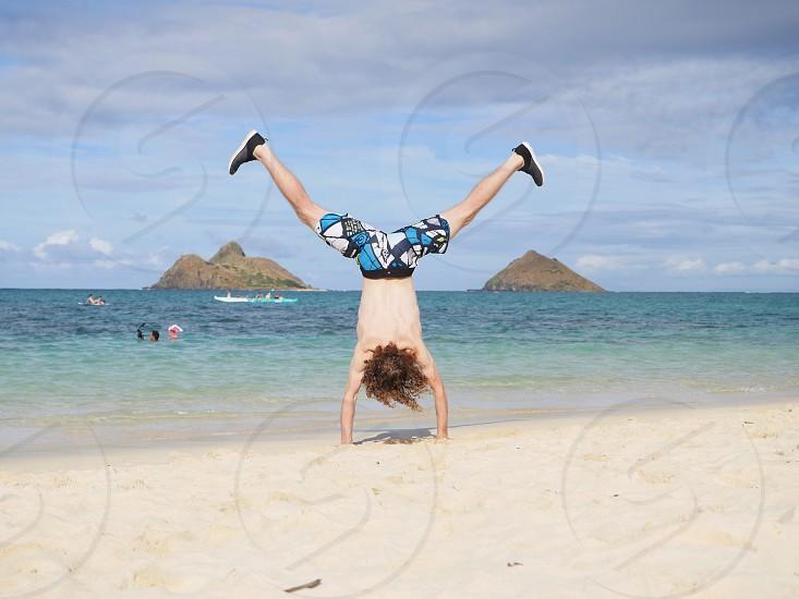 Summer time Hand stand on the beach in Hawaii Lanikai beach  photo