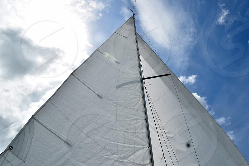 sail lake ocean sky sea wind boat sailboat mast jib wing on wing photo