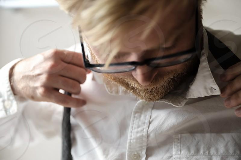 A man tying a tie. photo