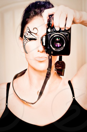 WEEKEND WARRIORS | What much else can I say I'm a photographer-I love to photograph as a hobby.  Me in the reflection of my mirror.  Wanted to show off the very artistic face paint my niece painted on me! photo