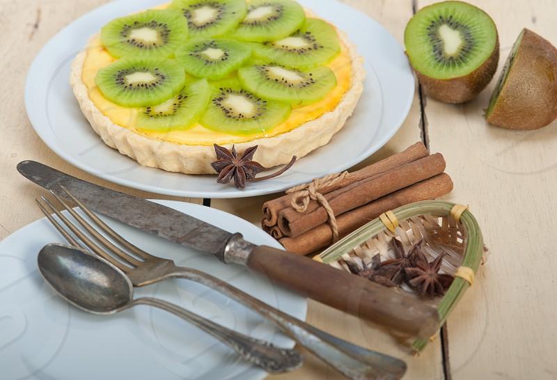 kiwi  pie tart with lemon custard cream and spices photo