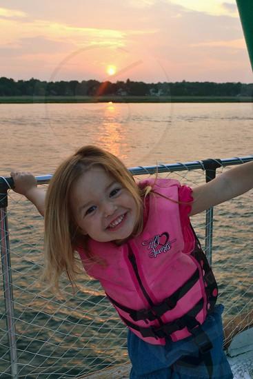 girl wearing pink life jacket photo