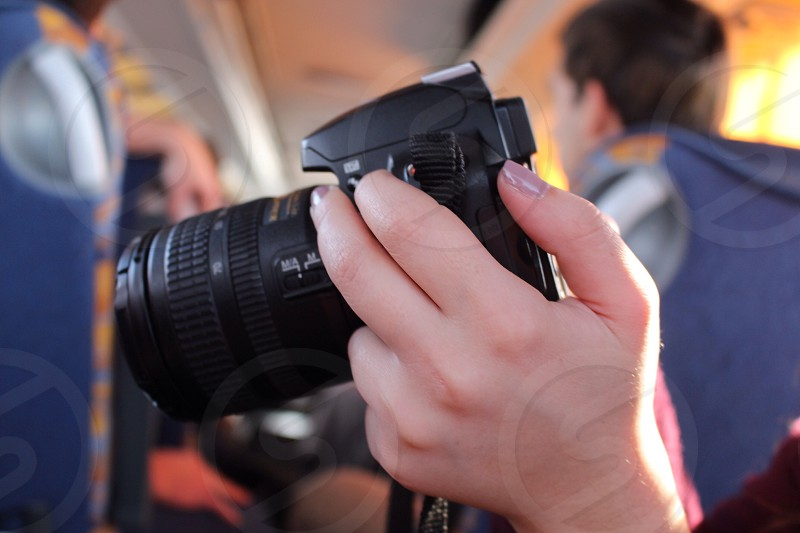 person holding a black dslr camera photo