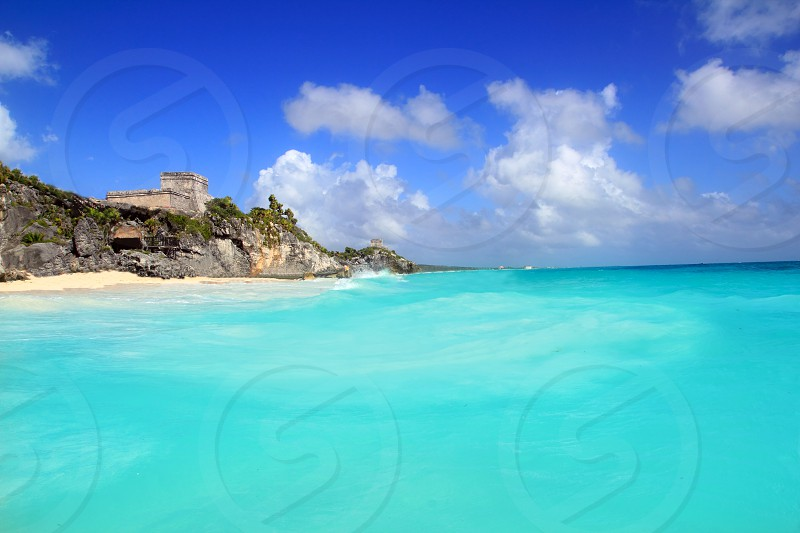 ancient Mayan ruins temple of Tulum in Caribbean turquoise sea shore photo