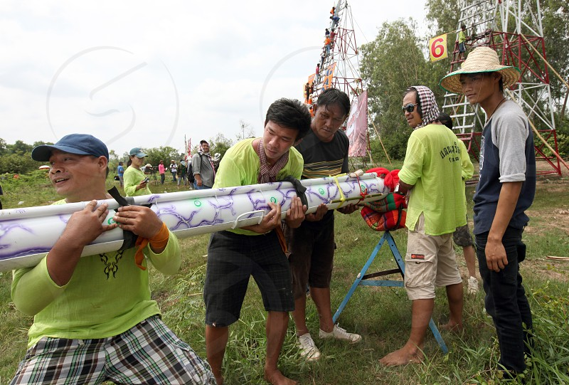 People of a Rocket Team at the Bun Bang Fai Festival or Rocket Festival in the City of Yasothon in the Region of Isan in Northeast Thailand in Thailand.