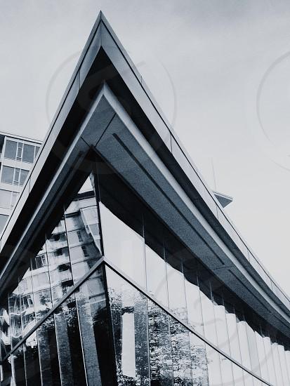 grayscale photo of glass window building photo