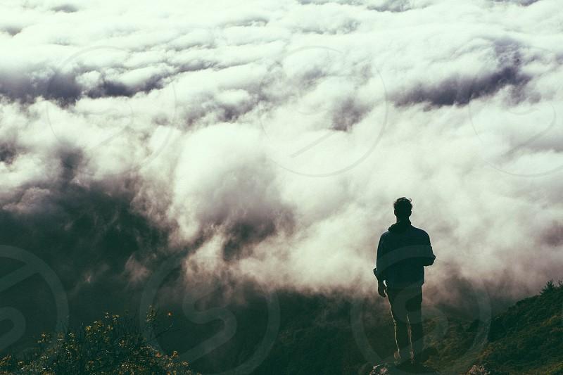 man facing white clouds photo