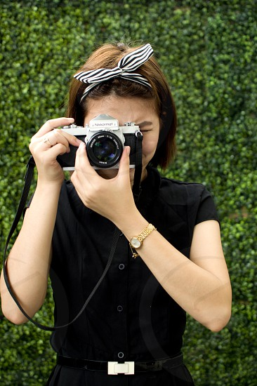 A woman is using a vintage camera photo