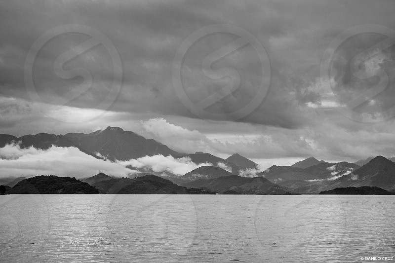 shore mountain sea weather clouds photo
