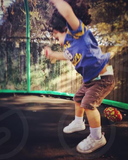 joyful jumping toddler boy photo
