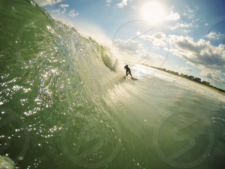 man surfing on ocean waves photo