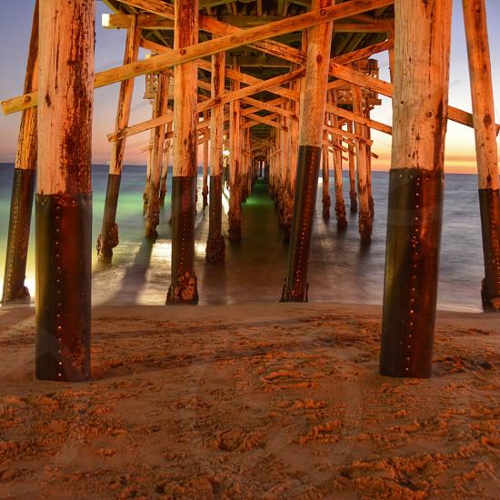 brown wooden bridge on body of water photo
