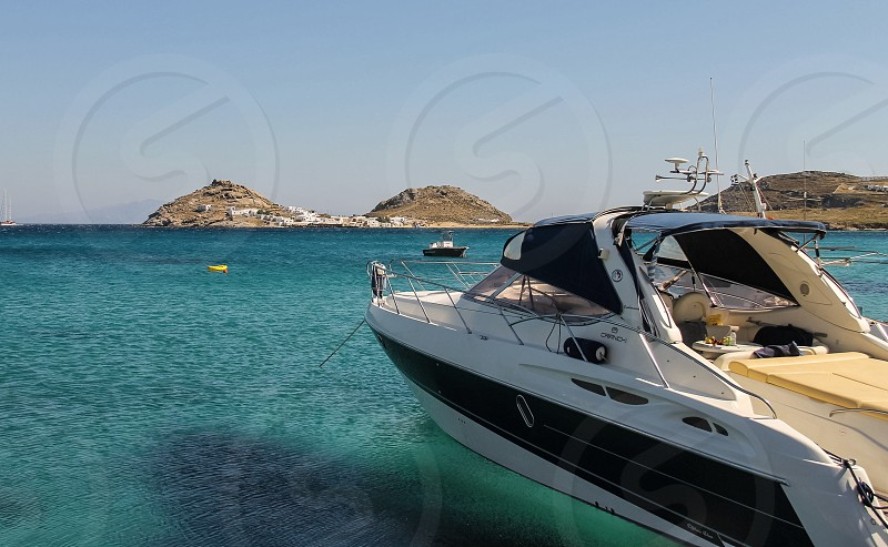 blue and white speed boat on the blue water photo