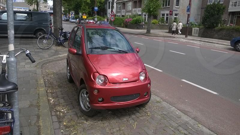 Holland Netherlands Alkmaar Small Car Tiny Car Europe Town Bike parked photo