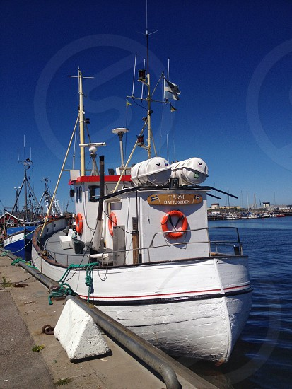 Fishing boat summer blue sky harbour photo