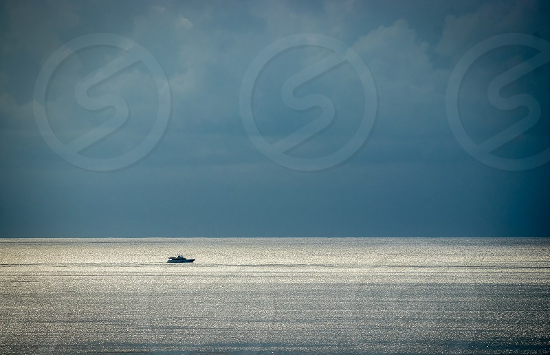 lonely boat in the big sea photo