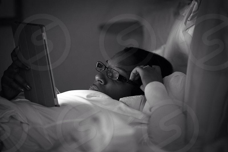 man using ipad grayscale photo photo