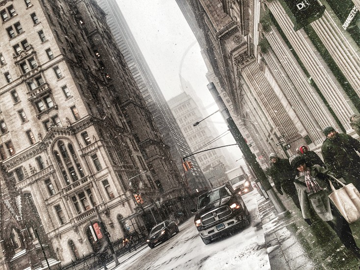 Wall Street NY. When snow just started and the streets were getting empty.  photo