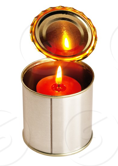 red candle on a tin can ovr white background photo