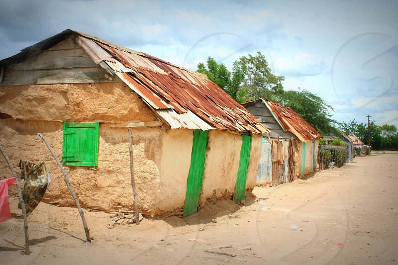 """""""Home sweet home""""  A Haitian village sits in the hot sun. photo"""