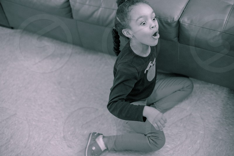 Excited girl on floor. photo