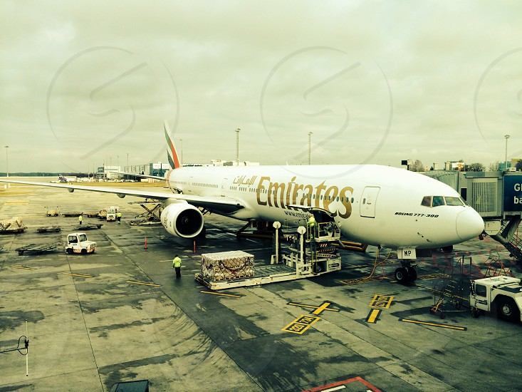 Emirates airline airplane at the airport getting ready for takeoff photo