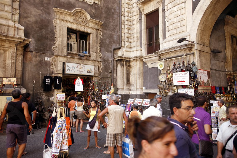 shops in the streets in the old Town of Catania in Sicily in south Italy in Europe. photo