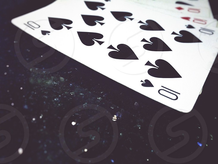 number 10 card playing cards focus black background  photo