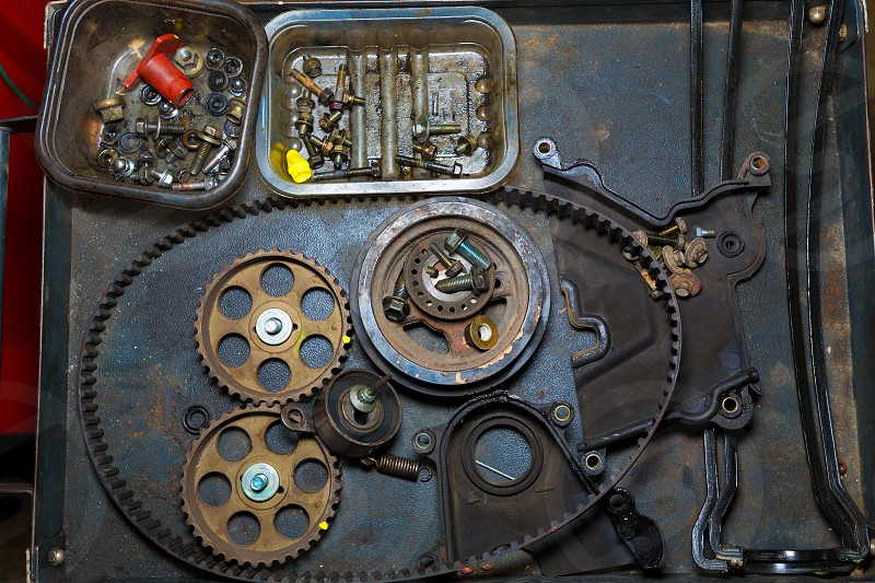 Car repair with belt and gears in grunge iron table photo
