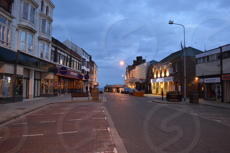 Empty downtown street in Bridlington United Kingdom at dusk with a cloudy sky. photo