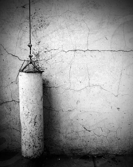 Man made stone falling apart cracks time architecture black and white photo