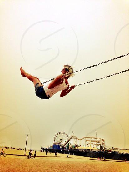 Swing fun beach California Venice blonde girl photo