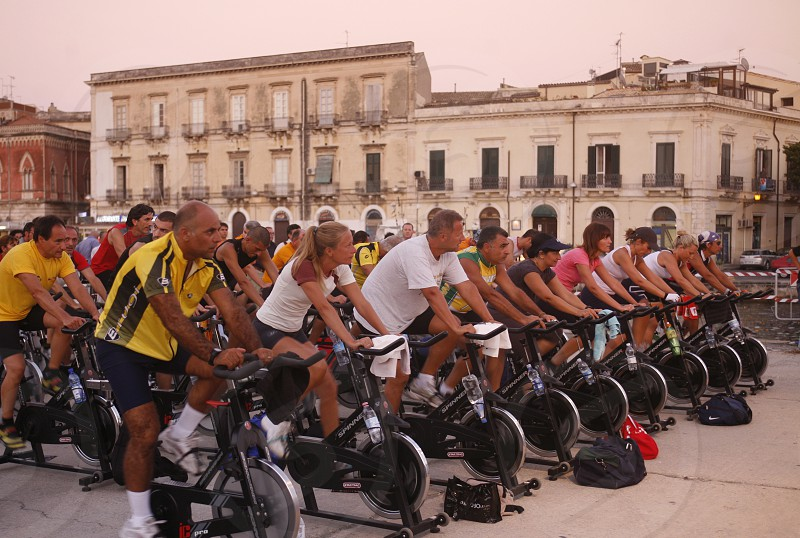 a fitness class in the old Town of Siracusa in Sicily in south Italy in Europe. photo