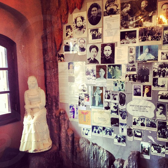 wall covered in photographs of people photo