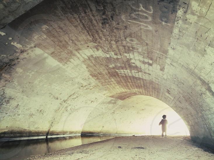boy in a tunnel photo