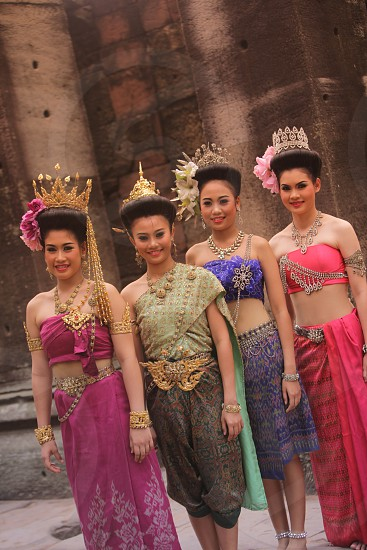 traditional dance at the phimai khmer Temple in the town of Phimai near the city of Khorat or Nakhon Ratchasima in the Region of Isan in Northeast Thailand in Thailand. photo