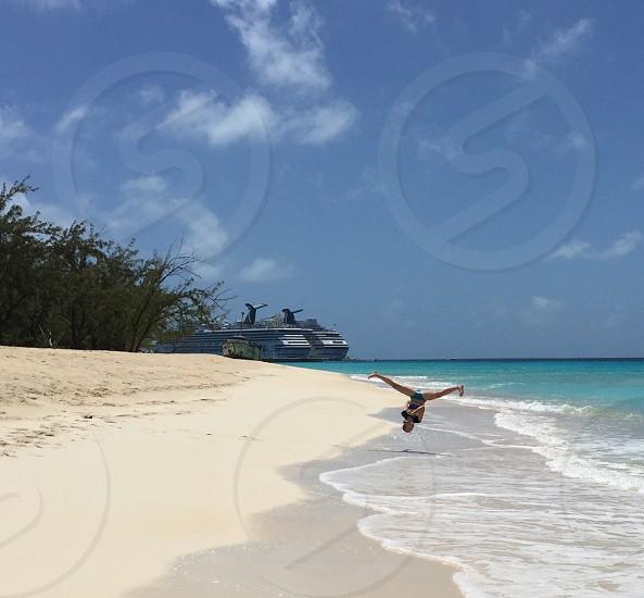 Vacation beach jumping. Ship travel photo