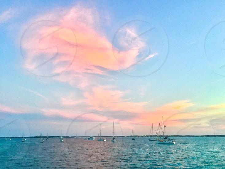 Sunset with sailboats off of Stocking Island in the Exumas Bahamas.  photo