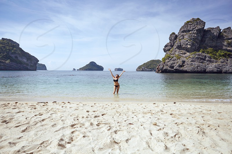 Beach Girl Woman Female Rock Tropical Blue Rocks Boulders Islands Sand Sea Ocean Water Bikini Bathers Summer photo