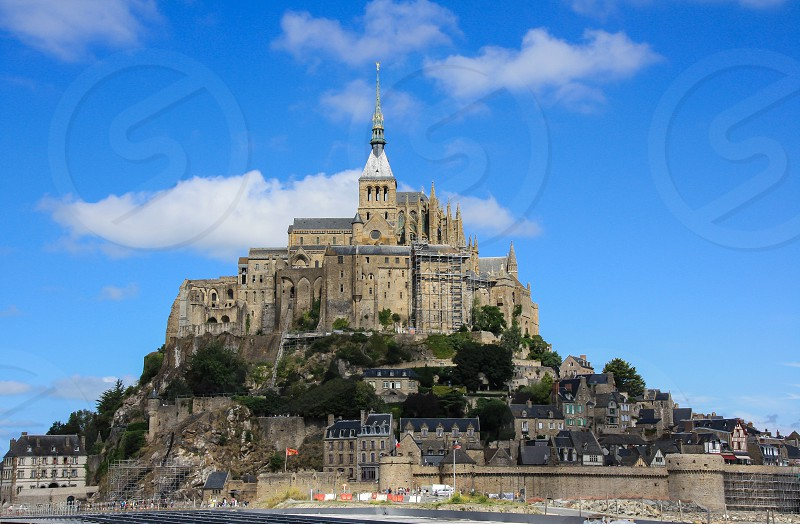The impressive rock and abbey of Mont St Michel under a blue sky in summer photo