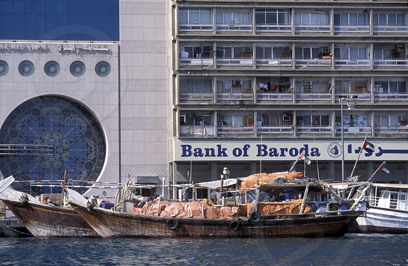 the bank of baroda on the Dubai creek in the old town in the city of Dubai in the Arab Emirates in the Gulf of Arabia. photo