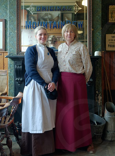 STANLEY COUNTY DURHAM/UK - JANUARY 20 : Two women Inside an old public house at the North of England Open Air Museum in Stanley County Durham on January 20 2018. Unidentified women photo