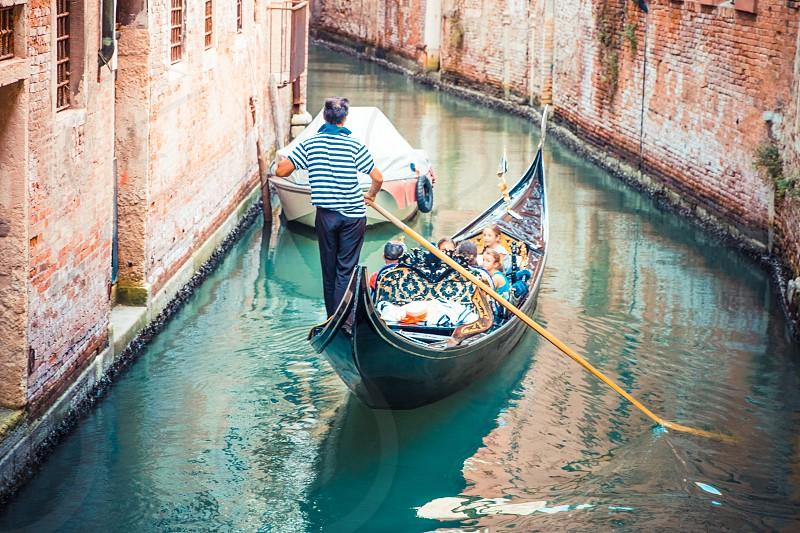 Gondola Family Ride In Venice photo