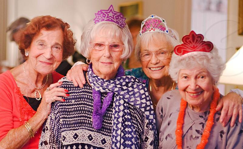 4 women standing beside each other photo