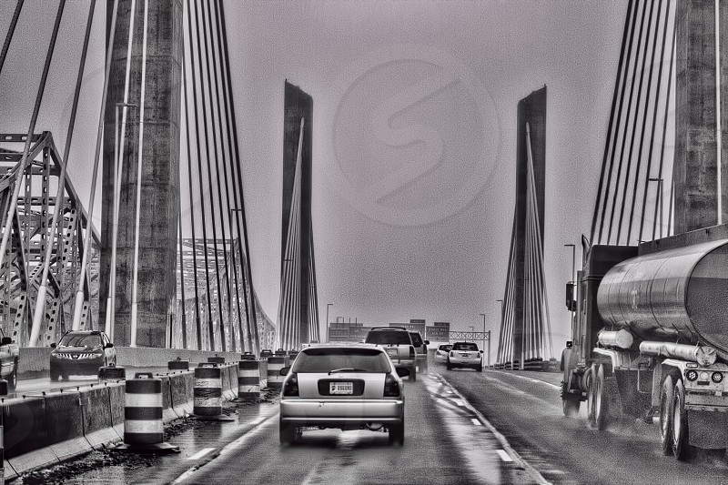 grayscale photography of road with vehicle photo