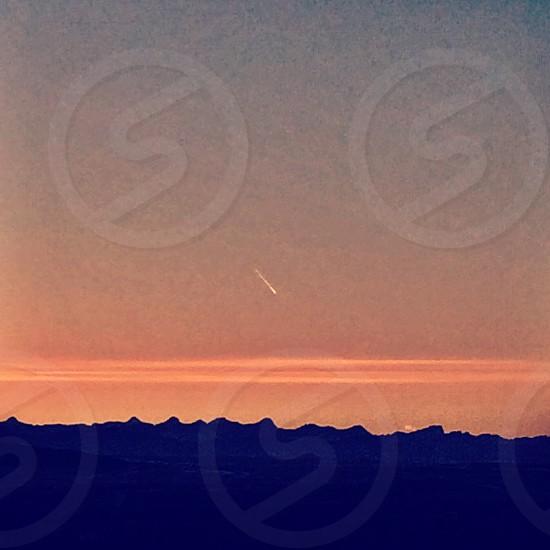 Sunset light streak mountains silhouettes  photo