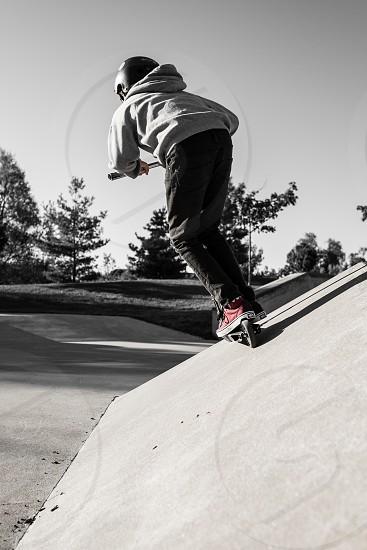 Scooter skills in the skatepark. photo