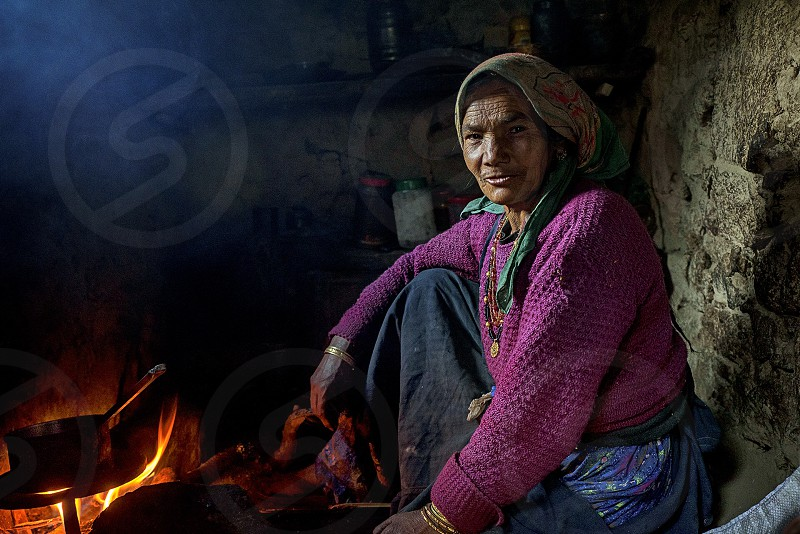 Cooking - She is a villager of a remote village of the Himalaya Mountain  India name Dronagiri at Garwal district . In spite of their hard life still they smiles and highly honoured guests attracts me to take this photograph. photo