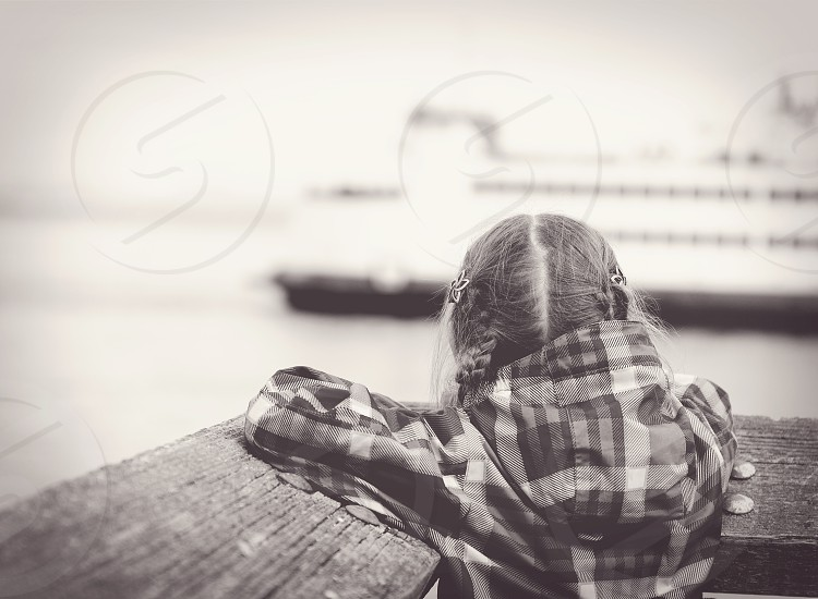 Girl looking at ferry boat Seattle Tacoma photo