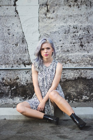 girl wearing a printed dress and black ankle boots photo